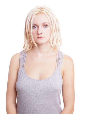 emotionless: young woman with blonde dreads and neutral expression Stock Photo