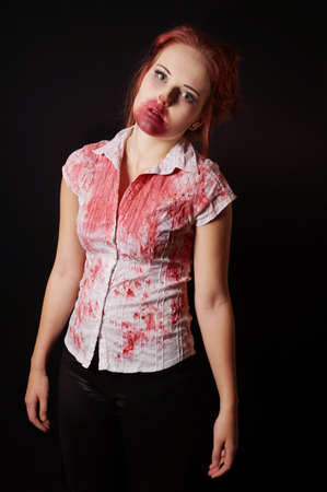necromancy: female zombie with bloody mouth and blouse on black background