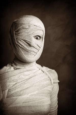 mummification: female mummy in grungy sepia vintage horror halloween style Stock Photo
