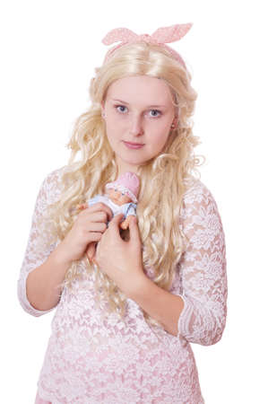 baby doll: cute young woman dressed up as a child holding a baby doll Stock Photo