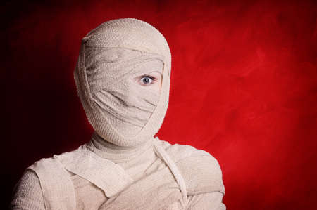 woman wrapped up with bandages as a mummy halloween costume photo