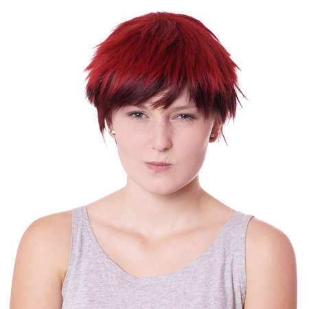 miffed: displeased young woman is making a face Stock Photo