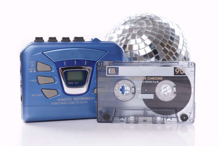 old-fashioned music cassette, walkman player and disco ball