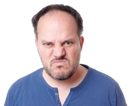 madman: angry middle aged man with madman grimace Stock Photo
