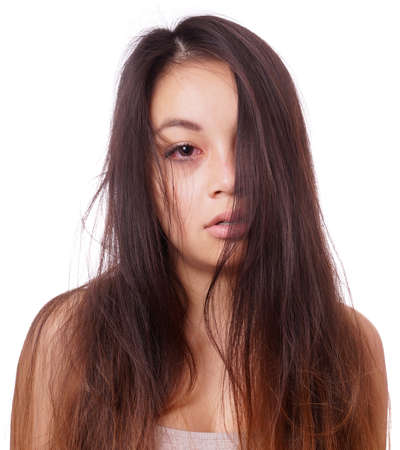 sad young asian woman with disheveled hair and red eyes from crying photo