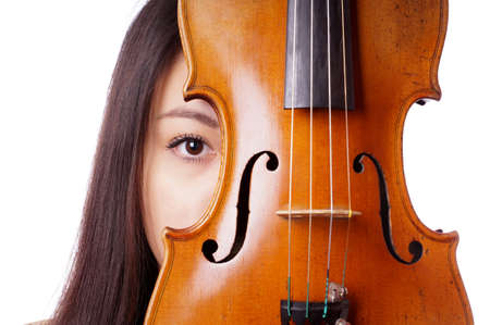 young asian woman peeking from behind violin or fiddle photo