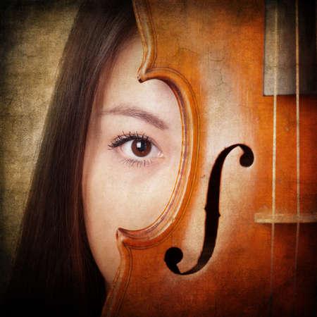 retro themed music concept girl portrait with violin photo