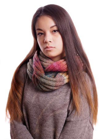 reserved young asian woman with neutral expression photo