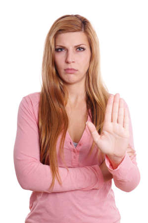mistrust: displeased young woman making stop gesture with her hand Stock Photo