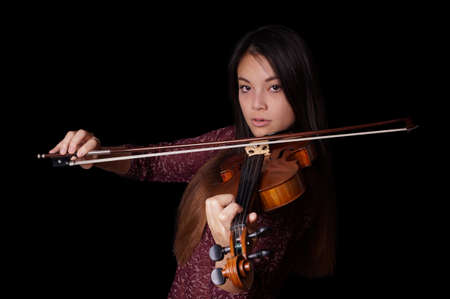 violin making: young asian woman playing violin or fiddle