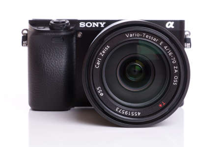 sony: Hannover, Germany - December 8, 2014: Photo of a Sony Alpha 6000 mirrorless interchangeable lens camera with Carl Zeiss zoom lens.