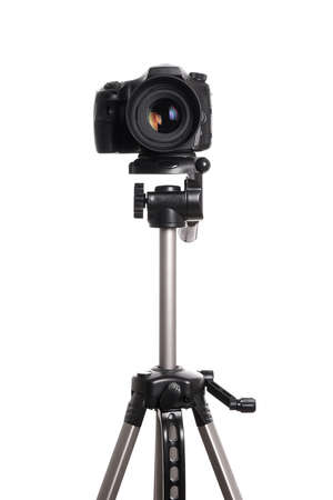 DSLR digital single lens reflex camera on a tripod isolated on white photo