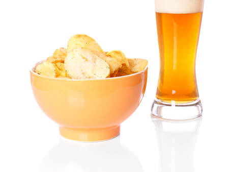 crisps: bowl of potato chips or crisps and a glass of wheat beer