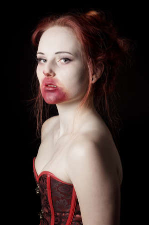 female vampire portrayed as a glamorous vamp photo