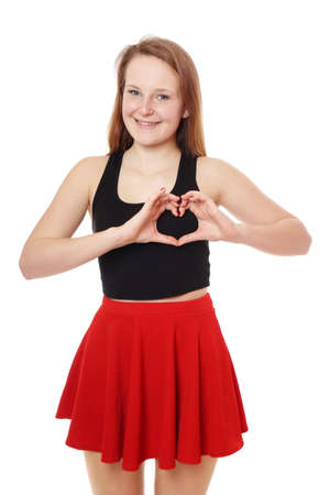 young woman making heart shape with her hands photo