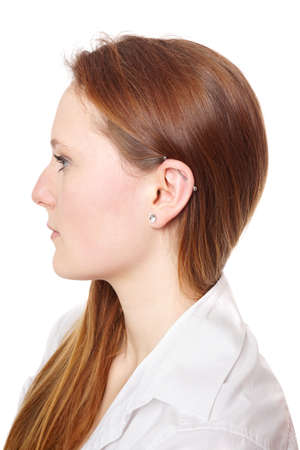body piercing: industrial piercing with barbell also known as scaffold or construction ear piercing