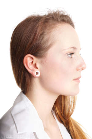 pierce: young woman with flesh tunnel ear lobe piercing