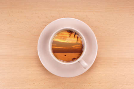 top angle: tropical sunset in a cup of coffee wanderlust concept