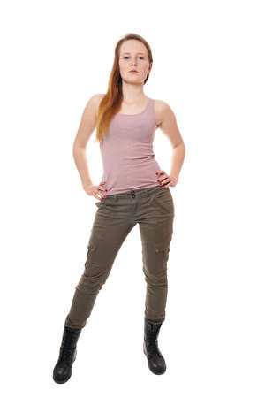 young woman wearing tank top, military style khaki pants and boots