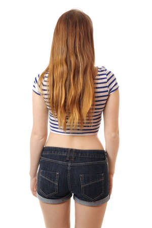 ass jeans: rear view of a young woman with long hair wearing hot pants
