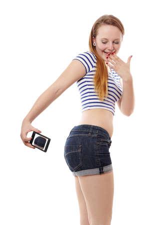 cheeky young woman taking a belfie or butt selfie