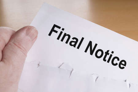 admonition: hand holding final notice or reminder letter
