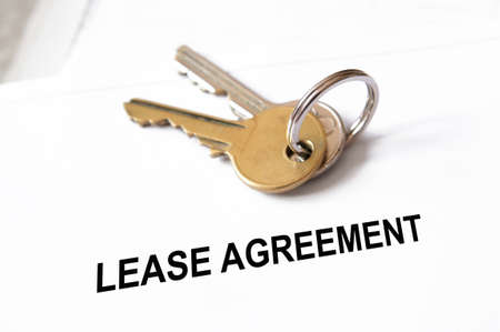 Leasing: lease agreement document with house keys Stock Photo