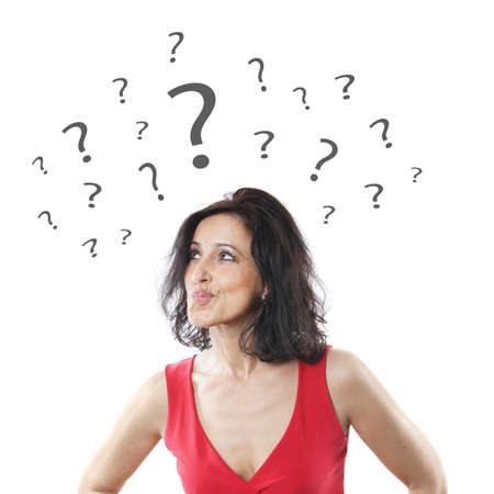 indecisive woman in her forties pouting with question marks Stock Photo
