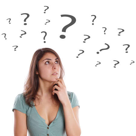 deliberate: pensive young woman looking up at question marks
