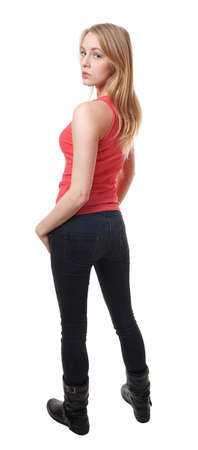 full length rear view of a slim young woman looking over her shoulder Stock Photo