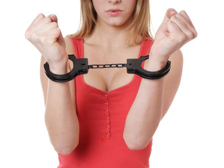 sex toy: unrecognizable busty young woman with sex toy handcuffs