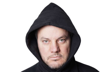 hoodlum: man wearing black hoodie isolated on white