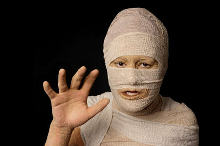 to creep: woman wrapped up with bandages as an egyptian mummy as halloween costume