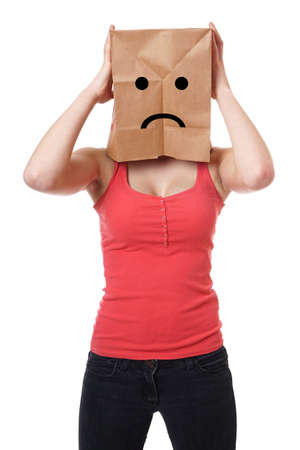 young woman wearing paper bag with sad smiley face over her head photo