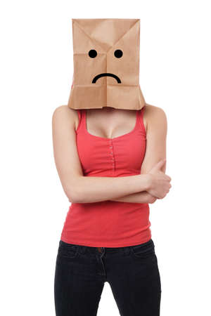 shy woman: young woman wearing paper bag with sad smiley face over her head
