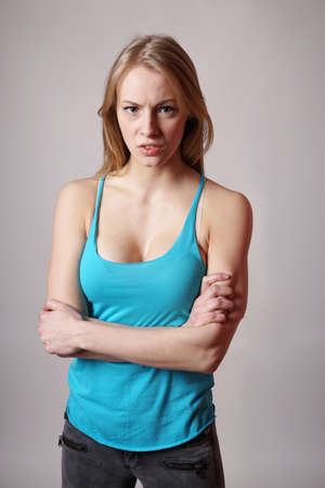 tough: strong tough young woman with arms folded