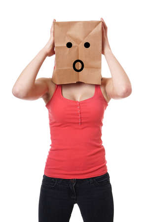 young woman wearing paper bag with shocked smiley face over her head photo