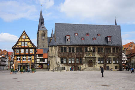 municipal editorial: Quedlinburg, Germany - April 16, 2015: Market square with City Hall, Market Church and half-timbered houses.
