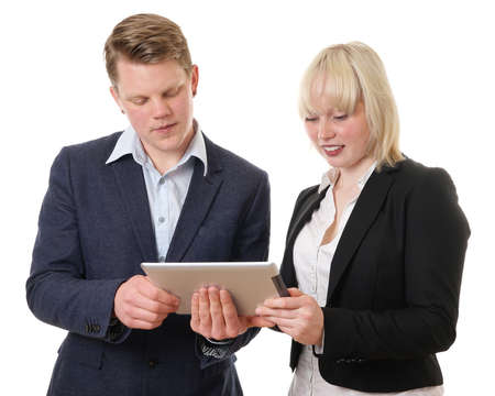 young business team looking at tablet computer photo