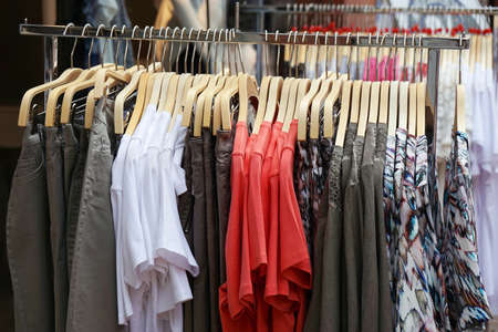 womens clothing: clothes rack with a selection of ladies fashion