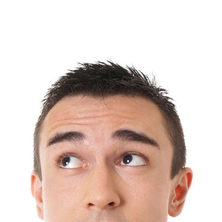 prying: male eyes looking up towards copy space Stock Photo