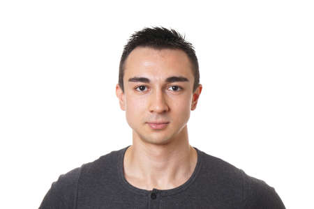 male face: head and shoulder portrait of a handsome young man with short dark hair