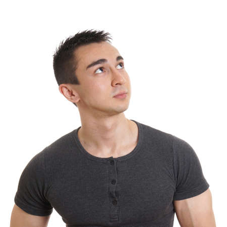 contemplative: contemplative young man looking up towards copy space