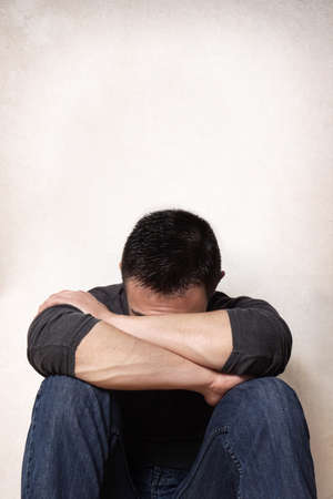 depression sad young man hiding his face Stock Photo