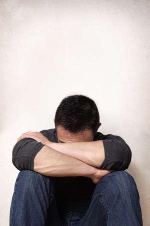 heartbroken: depression sad young man hiding his face Stock Photo