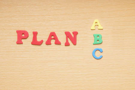 businessplan: plan a or b or c spelled with colorful foam rubber letters