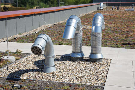 venting: roof vent or ventilation pipes on flat roof Stock Photo