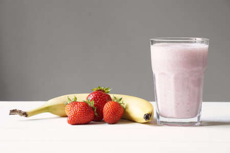 homemade strawberry and banana smoothie or milk shake
