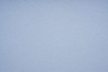 faux or imitation leather background texture in light blue
