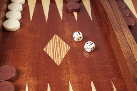 double game: double six or boxcars, rolling dice on backgammon board game Stock Photo